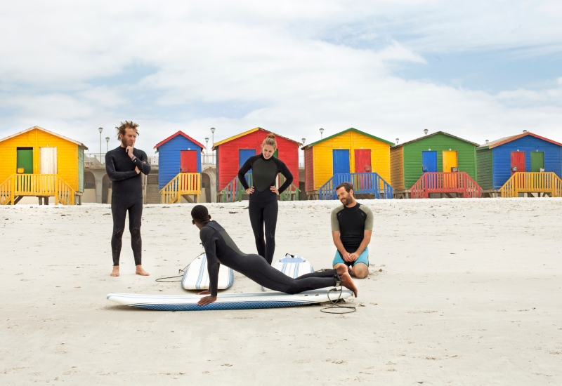 Guests learn to surf during Waves for Change's Cape Town Airbnb experience, Surf with Purpose