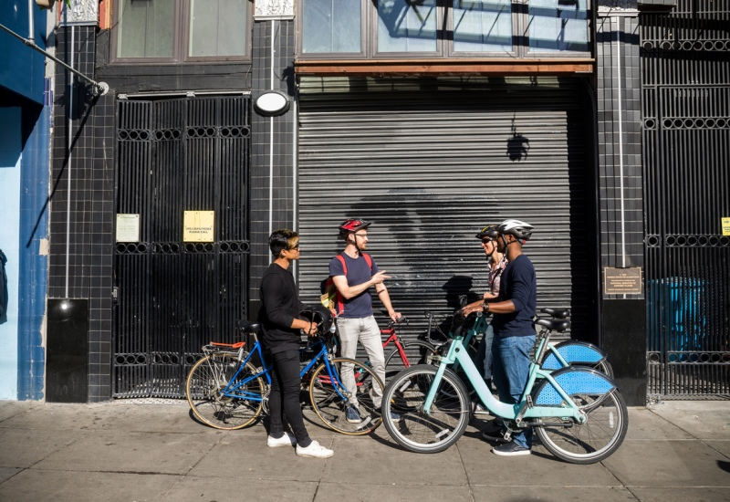 Guests talk during Jack's Airbnb bike experience Cruise through queer history