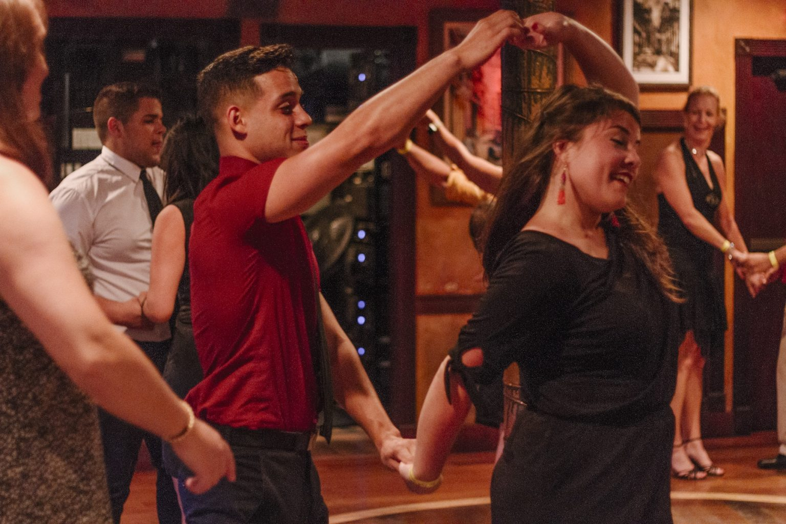 Experience host Kevin leads a dancer during his Miami Airbnb experience Salsa & Bachata Night in Miami