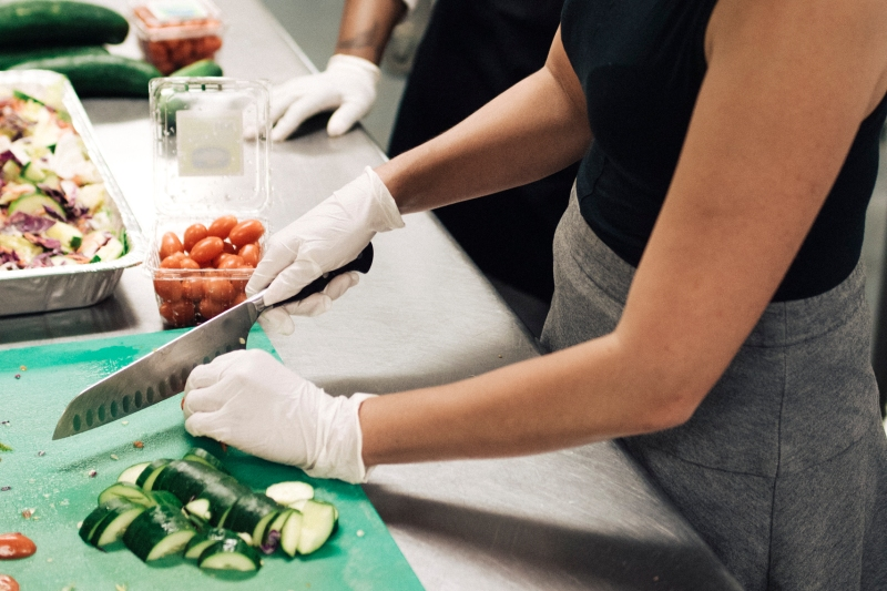 Chopping vegetables during Stephanie's New York Airbnb experience, Top Chef Competition
