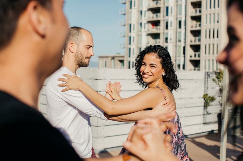 Couples dance on a rooftop during Rob's Airbnb experience Mission Salsa Dancing