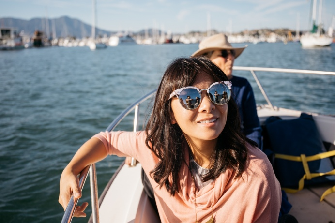 Happy passengers on an Airbnb sailboat experience in San Francisco Bay