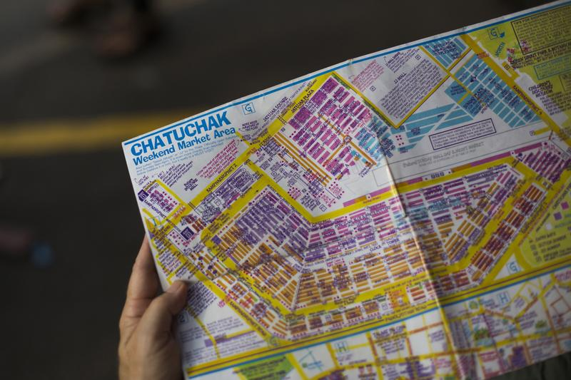 A tourist holds a map of Chatuchak