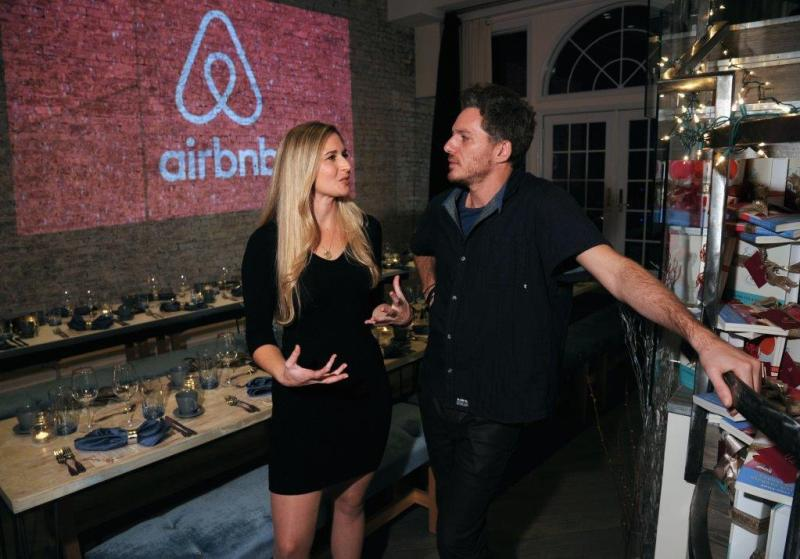 Lizzie Post & Spike Mendelsohn chatting at Airbnb's Holiday Dinner
