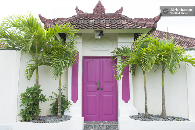 Bright pink door, villa in Bali