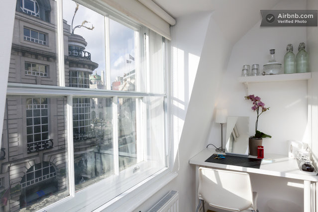 Writing desk and window overlooking Piccadilly Circus, London