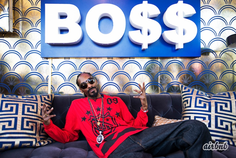 Snoop Doog in his boss pop-up house designed by Snoop and Emily Henderson